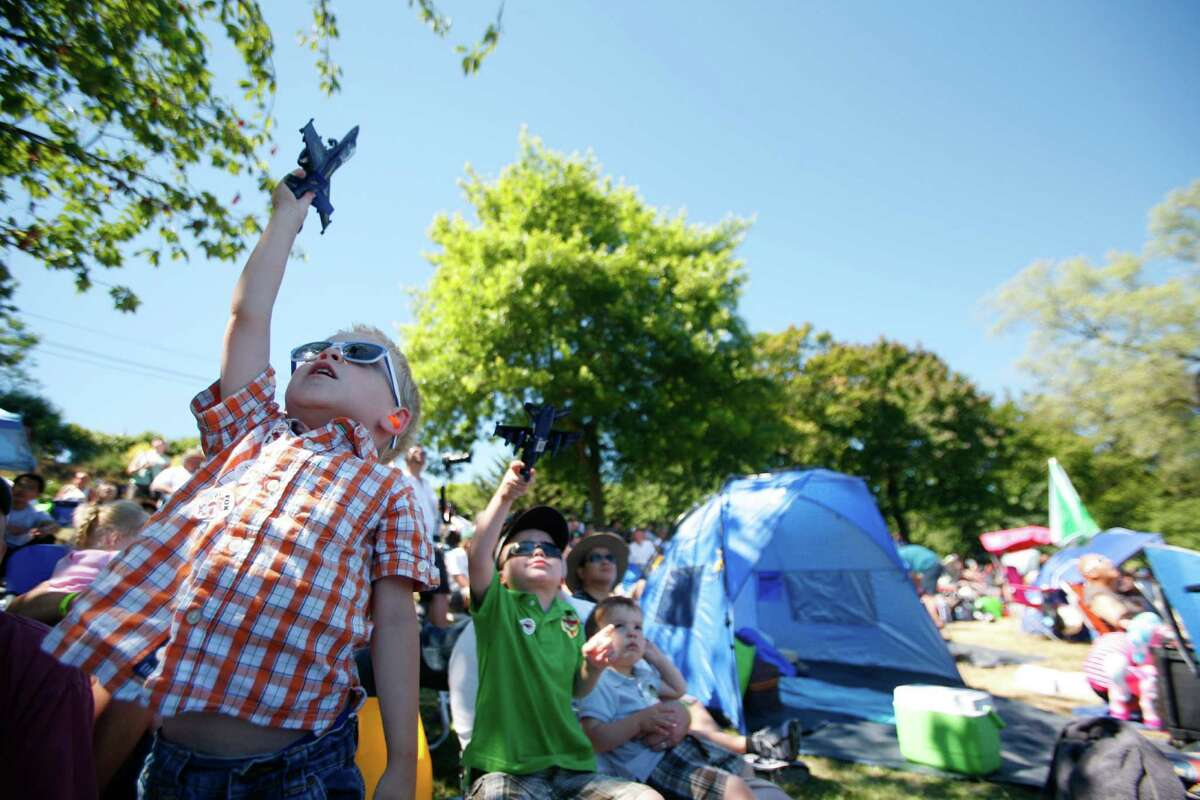 Austin Hedgpeth, 3, plays with his toy Blue Angel during Seafair in Seattle on Lake Washington on Saturday, Aug. 4, 2012.