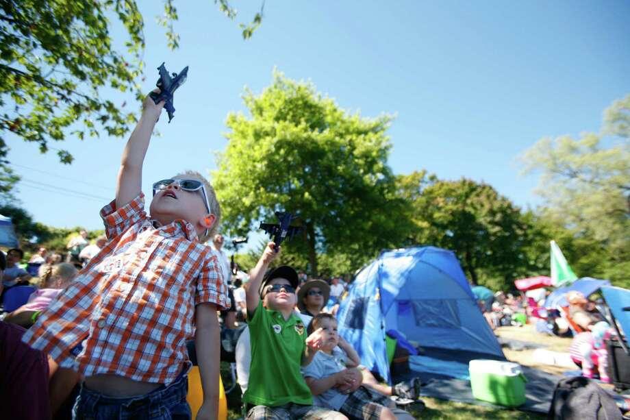 Austin Hedgpeth, 3, plays with his toy Blue Angel during Seafair in Seattle on Lake Washington on Saturday, Aug. 4, 2012. Photo: Sofia Jaramillo / SEATTLEPI.COM