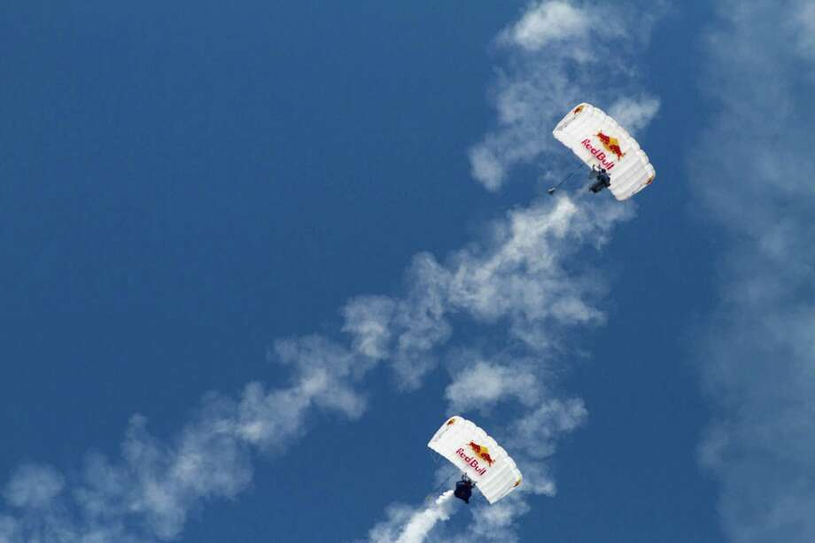Two skydivers prepare to land during a Red Bull air demonstration. Photo: Sofia Jaramillo / SEATTLEPI.COM