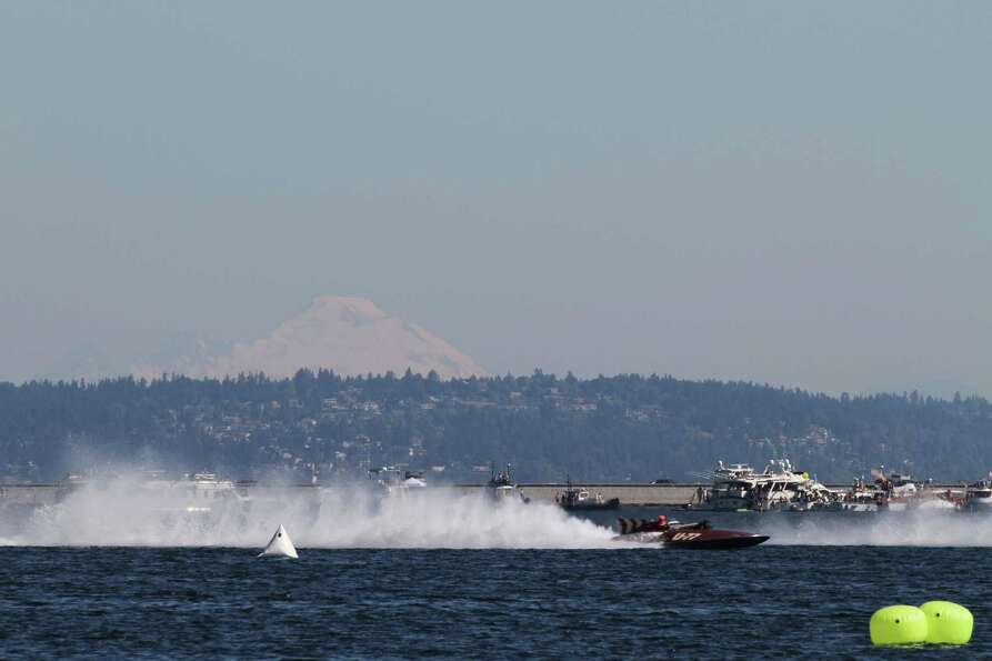 A vintage hydroplane races around Lake Washington.