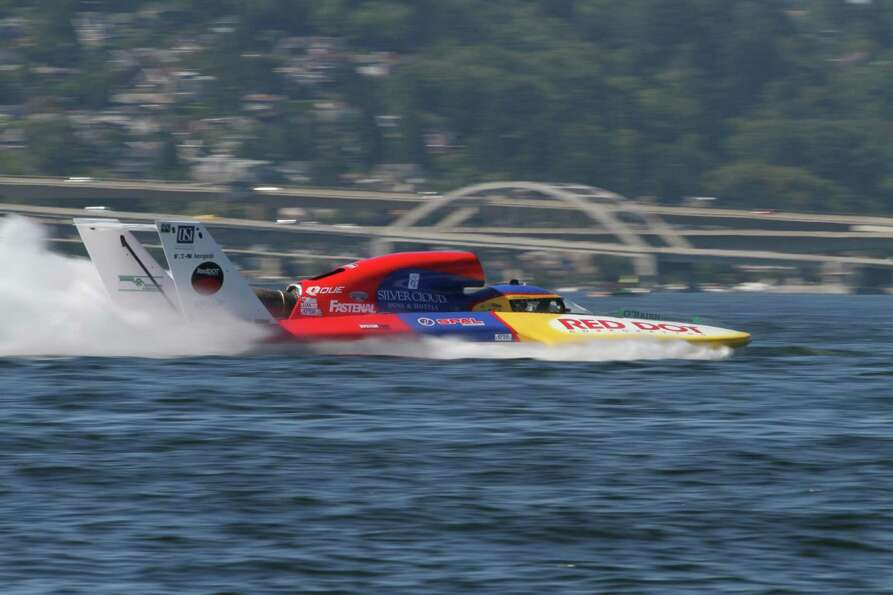 The Miss Red Dot H1 Unlimited boat races on Lake Washington.