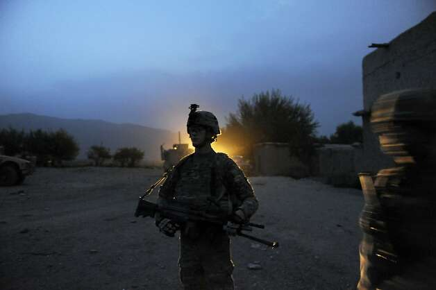 An American ISAF solider from team Apache of Task Force Geronimo, 4th Platoon Delaware of the United States Army, gets ready for a patrol in Mans Kalay village in Sabari, Khost district on August 4, 2012. ISAF has noted a surge in attacks in recent months since the start of the Taliban's annual summer offencive. Photo: Jose Cabezas, AFP/Getty Images / SF