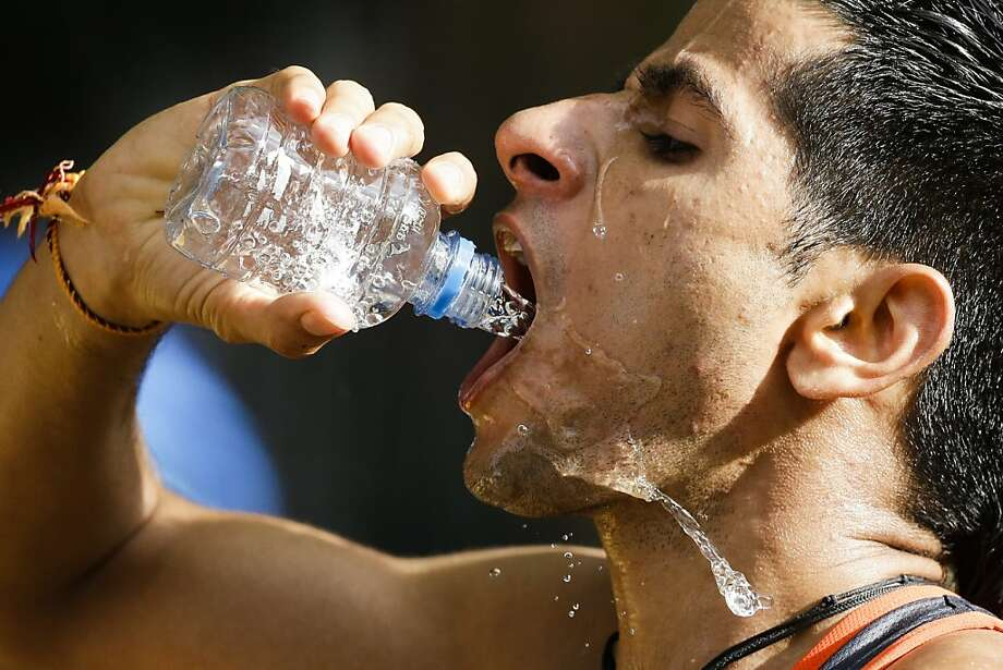 Baljinder Singh of India opted for water in his 20- kilometer racewalking event at the London Olympics. Photo: Markus Schreiber, Associated Press