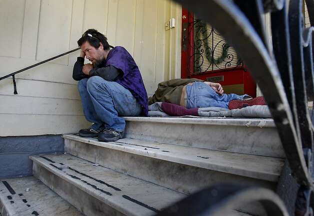 Roland Dequina (left) sits with his friend Justin O'Brien on the steps of a residential building owned by the local Catholic Church.  Dequina and O'Brien have over 50 sit/lie citations. In the first year of enforcement, the San Francisco Police department handed out dozens of sit/lie citations, mostly to longtime homeless people who have problems with alcohol. Photo: Brant Ward, The Chronicle