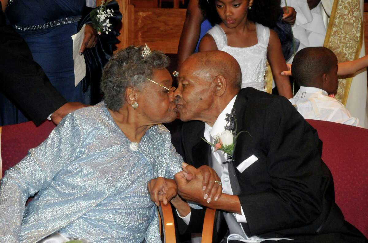 Roland Davis and Lena Henderson kiss after getting remarried Saturday, Aug. 4 2012, at the Elim Christian Fellowship Church in Buffalo, N.Y. They got hitched while still in their teens, divorced 20 years and four children later, and got remarried Saturday after nearly a half-century apart.