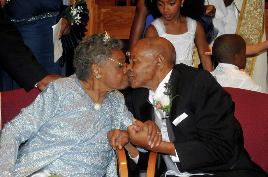 Roland Davis and Lena Henderson kiss after getting remarried Saturday, Aug. 4 2012, at the Elim Christian Fellowship Church in Buffalo, N.Y. They got hitched while still in their teens, divorced 20 years and four children later, and got remarried Saturday after nearly a half-century apart. Photo: Dan Cappellazzo, AP / FR170202 AP
