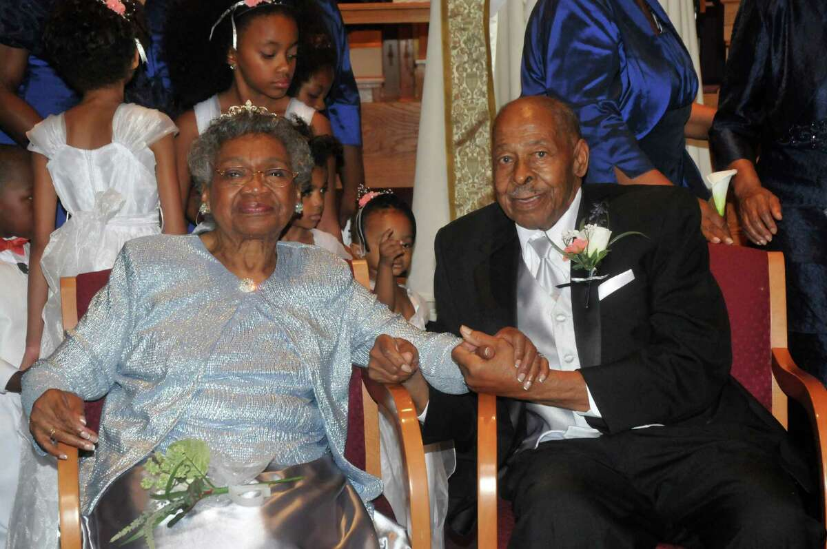 Roland Davis and Lena Henderson hold hands after getting remarried, Saturday, Aug. 4 2012, at the Elim Christian Fellowship Church in Buffalo, N.Y. They got hitched while still in their teens, divorced 20 years and four children later, and got remarried Saturday after nearly a half-century apart.