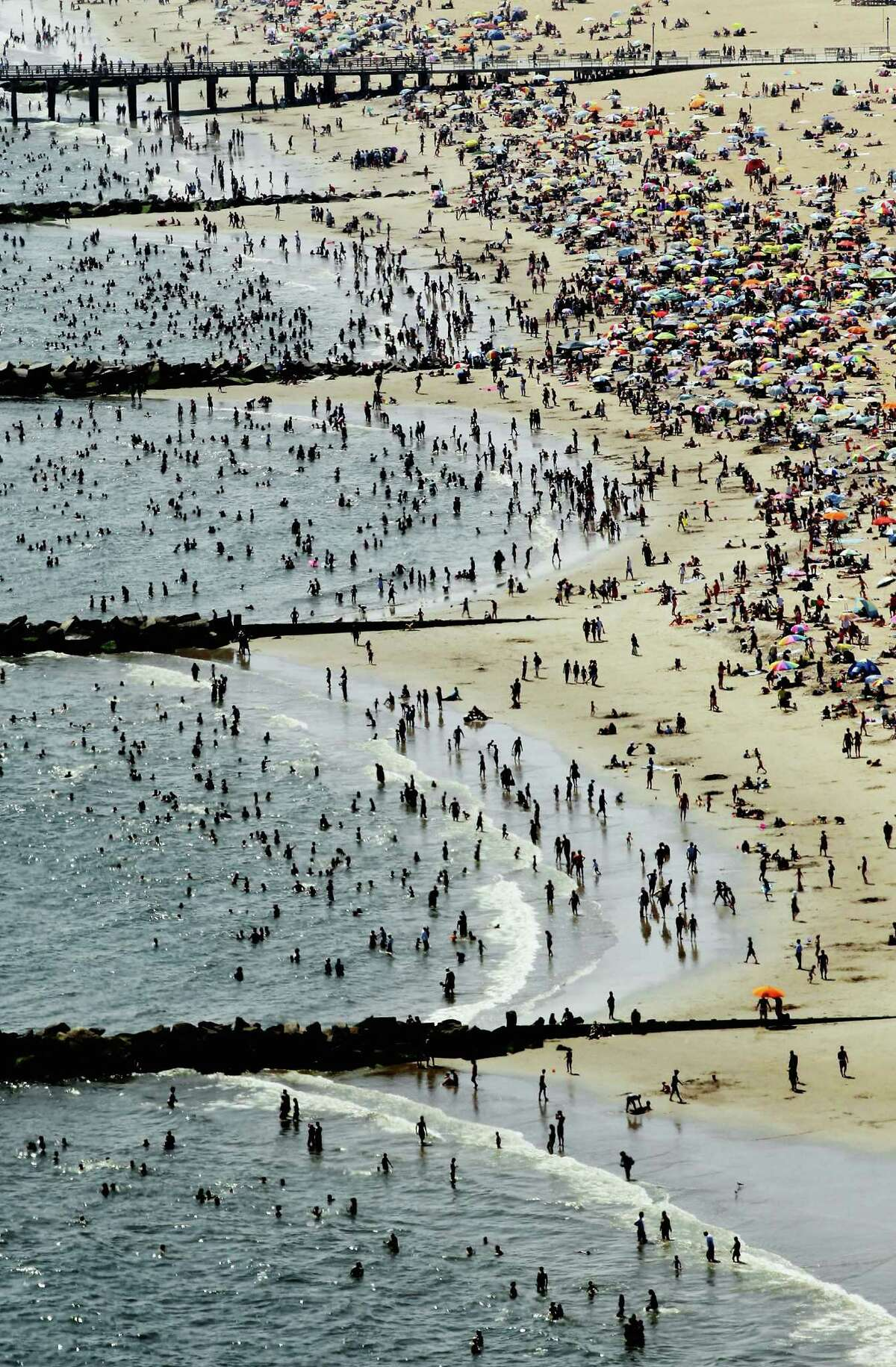 NEW YORK, NY - AUGUST 04: An aerial view of New Yorkers taking in the sun on a beach at Coney Island on August 4, 2012 in the Brooklyn borough of New York City. The past year through June 2012 in the continental United States has been the hottest since modern record-keeping started in 1895, according to the National Oceanic and Atmospheric Administration (NOAA). NOAA also reports the ten warmest years since 1895 have occurred since 2000. A weather expert at the agency suggested climate change has a role in the high temperatures.