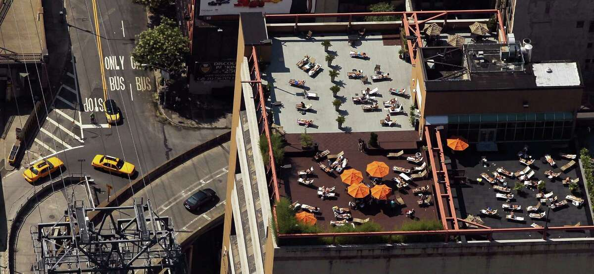 NEW YORK, NY - AUGUST 04: An aerial view of New Yorkers taking in the sun on Manhattan rooftops on August 4, 2012 in New York City. The past year through June 2012 in the continental United States has been the hottest since modern record-keeping started in 1895, according to the National Oceanic and Atmospheric Administration (NOAA). NOAA also reports the ten warmest years since 1895 have occurred since 2000. A weather expert at the agency suggested climate change has a role in the high temperatures.