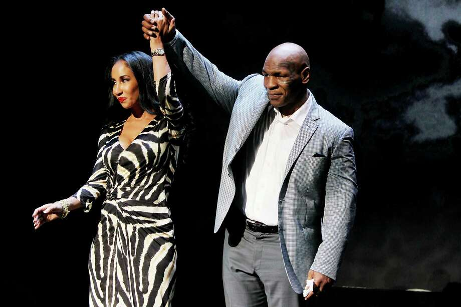 "This image released by Starpix shows, former boxer Mike Tyson, right, and his wife Kiki Tyson at the curtain call for the opening night of ""Mike Tyson: Undisputed Truth,"" Thursday, Aug. 2, 2012 at the Longacre Theatre in New York.  The one man show starring Tyson was directed by Spike Lee, and written by Kiki Tyson. Photo: Amanda Schwab, AP / STARPIX"