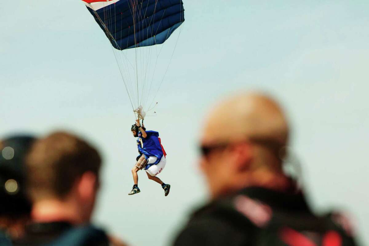 A skydiver prepares to land, Thursday, Aug. 2, 2012, in Ottawa, Ill. More than 140 skydivers reaching speeds in excess of 180 mph gathered in the skies over central Illinois to set a new world record in vertical flying. Falling at speeds of up to 220 mph, a group of nearly 140 skydivers shattered the vertical skydiving world record as they flew heads-down in a massive snowflake formation in northern Illinois.