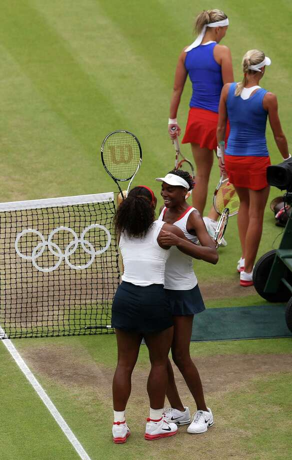 LONDON, ENGLAND - AUGUST 05:  Serena Williams (L) and Venus Williams (R) of the United States celebrate after defeating Andrea Hlavackova and Lucie Hradecka of Czech Republic in the Women's Doubles Tennis gold medal match on Day 9 of the London 2012 Olympic Games at the All England Lawn Tennis and Croquet Club on August 5, 2012 in London, England. Photo: Clive Brunskill, Getty Images / 2012 Getty Images