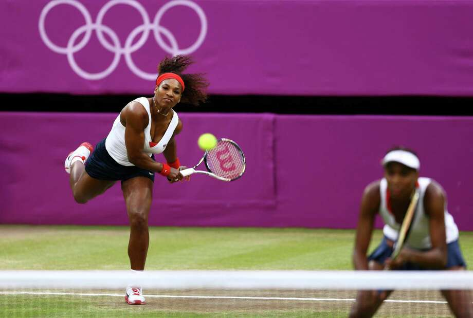 LONDON, ENGLAND - AUGUST 05:  Serena Williams (L) and Venus Williams (R) of the United States serve the ball to Andrea Hlavackova and Lucie Hradecka of Czech Republic during the Women's Doubles Tennis gold medal match on Day 9 of the London 2012 Olympic Games at the All England Lawn Tennis and Croquet Club on August 5, 2012 in London, England. Photo: Paul Gilham, Getty Images / 2012 Getty Images