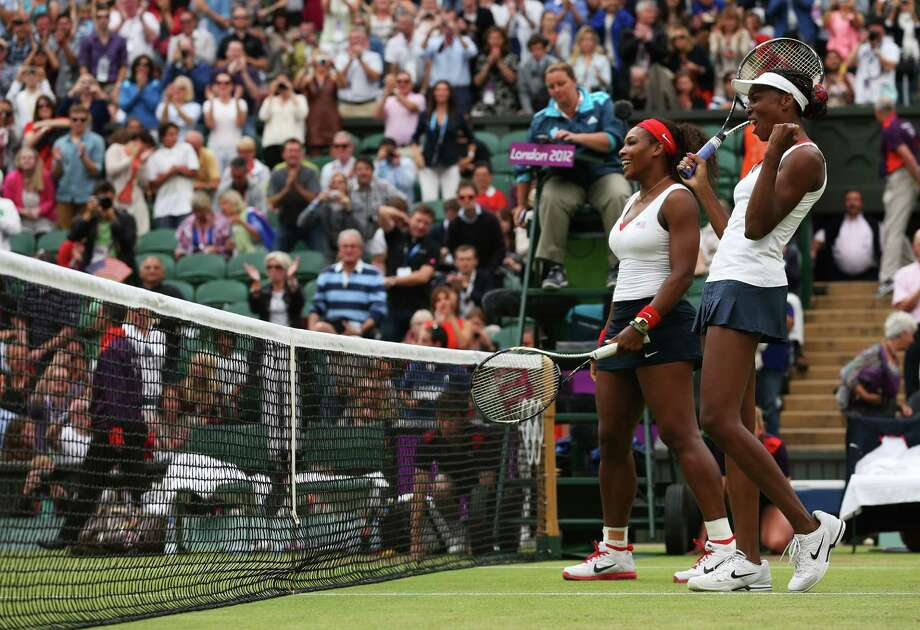 LONDON, ENGLAND - AUGUST 05:  Serena Williams (L) and Venus Williams (R) of the United States celebrate after defeating Andrea Hlavackova and Lucie Hradecka of Czech Republic in the Women's Doubles Tennis gold medal match on Day 9 of the London 2012 Olympic Games at the All England Lawn Tennis and Croquet Club on August 5, 2012 in London, England. Photo: Julian Finney, Getty Images / 2012 Getty Images
