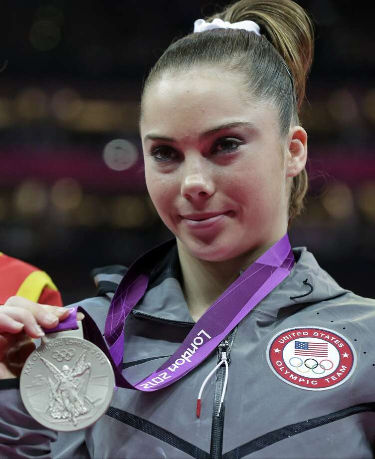 U.S. gymnast McKayla Maroney displays her silver medal during the podium ceremony for the artistic gymnastics women's vault finals at the 2012 Summer Olympics, Sunday, Aug. 5, 2012, in London. (AP Photo/Julie Jacobson) (Julie Jacobson / Associated Press)