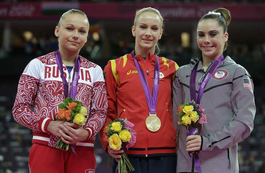 Russian gymnast Maria Paseka, left, Romania's gymnast Sandra Raluca Izbasa, center, and U.S. gymnast McKayla Maroney stand during the podium ceremony for the artistic gymnastics women's vault finals at the 2012 Summer Olympics, Sunday, Aug. 5, 2012, in London. (AP Photo/Julie Jacobson) (Julie Jacobson / Associated Press)