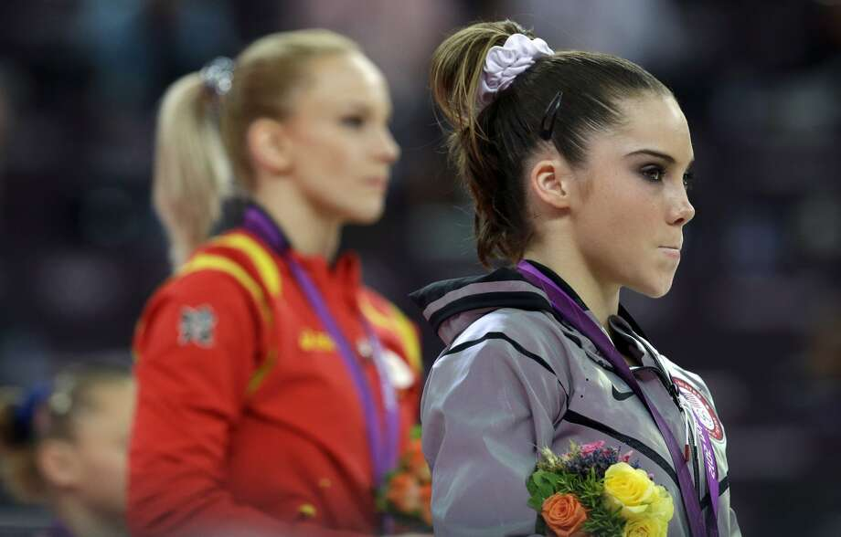U.S. gymnast McKayla Maroney, right, stand along with Romania's gymnast Sandra Raluca Izbasa during the podium ceremony for the artistic gymnastics women's vault finals at the 2012 Summer Olympics, Sunday, Aug. 5, 2012, in London.  (AP Photo/Julie Jacobson) (Julie Jacobson / Associated Press)