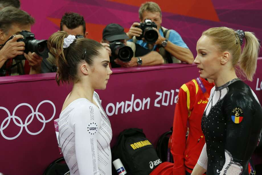 US Kayla Mc Maroney (L) listens to Romania's Sandra Raluca Izbasa after the women's vault final of the artistic gymnastics event of the London Olympic Games on August 5, 2012 at the 02 North Greenwich Arena in London. Izbasa won the gold medal and Mc Maroney the silver medal.AFP PHOTO / THOMAS COEXTHOMAS COEX/AFP/GettyImages (THOMAS COEX / AFP/Getty Images)