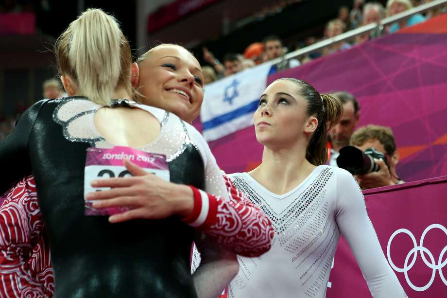 LONDON, ENGLAND - AUGUST 05:  (L-R) Sandra Raluca Izbasa of Romania and Maria Paseka of Russia embrace as Mc Kayla Maroney of the United States looks on during the Artistic Gymnastics Women's Vault Final on Day 9 of the London 2012 Olympic Games at North Greenwich Arena on August 5, 2012 in London, England.  (Photo by Ronald Martinez/Getty Images) (Ronald Martinez / Getty Images)