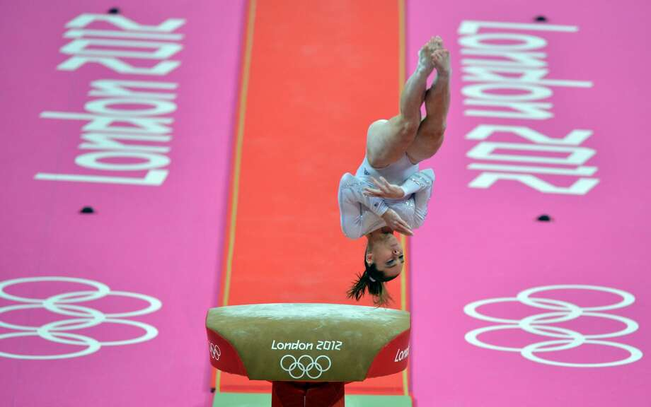 US Kayla Mc Maroney competes during the women's vault final of the artistic gymnastics event of the London Olympic Games on August 5, 2012 at the 02 North Greenwich Arena in London. Mc Maroney won the silver medal. AFP PHOTO / BEN STANSALLBEN STANSALL/AFP/GettyImages (BEN STANSALL / AFP/Getty Images)