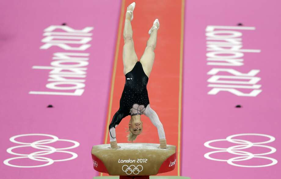 Romania's gymnast Sandra Raluca Izbasa performs during the artistic gymnastics women's vault final at the 2012 Summer Olympics, Sunday, Aug. 5, 2012, in London. (AP Photo/Gregory Bull) (Gregory Bull / Associated Press)