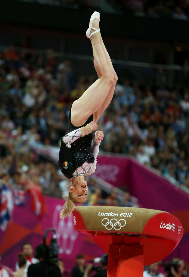 LONDON, ENGLAND - AUGUST 05:  Sandra Raluca Izbasa of Romania competes in the Artistic Gymnastics Women's Vault final on Day 9 of the London 2012 Olympic Games at North Greenwich Arena on August 5, 2012 in London, England.  (Photo by Quinn Rooney/Getty Images) (Quinn Rooney / Getty Images)