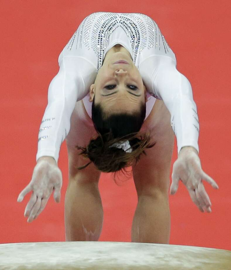 U.S. gymnast McKayla Maroney performs during the artistic gymnastics women's vault  final at the 2012 Summer Olympics, Sunday, Aug. 5, 2012, in London. (AP Photo/Gregory Bull) (Gregory Bull / Associated Press)