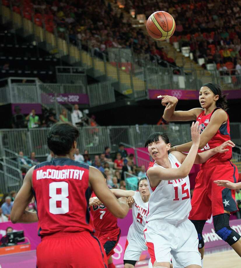 USA's Candace Parker (15) passes the ball to teammate Angel McCoughtry (8) over China's Chen Nan (15) during their game at the Basketball Arena at the Olympic Park during the 2012 Summer Olympic Games in London, England, Sunday, August 5, 2012. (Harry E. Walker/MCT) Photo: Harry E. Walker, McClatchy-Tribune News Service / Harry E. Walker, Copyright 2012