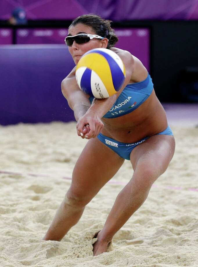 Marta Menegatti of Italy returns the ball during a two set loss to the United States during a beach volleyball match at the 2012 Summer Olympics, Sunday, Aug. 5, 2012, in London. (AP Photo/Dave Martin) Photo: Dave Martin, Associated Press / AP