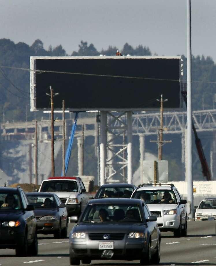 A development deal calls  for more digital billboards. Photo: Paul Chinn, SFC