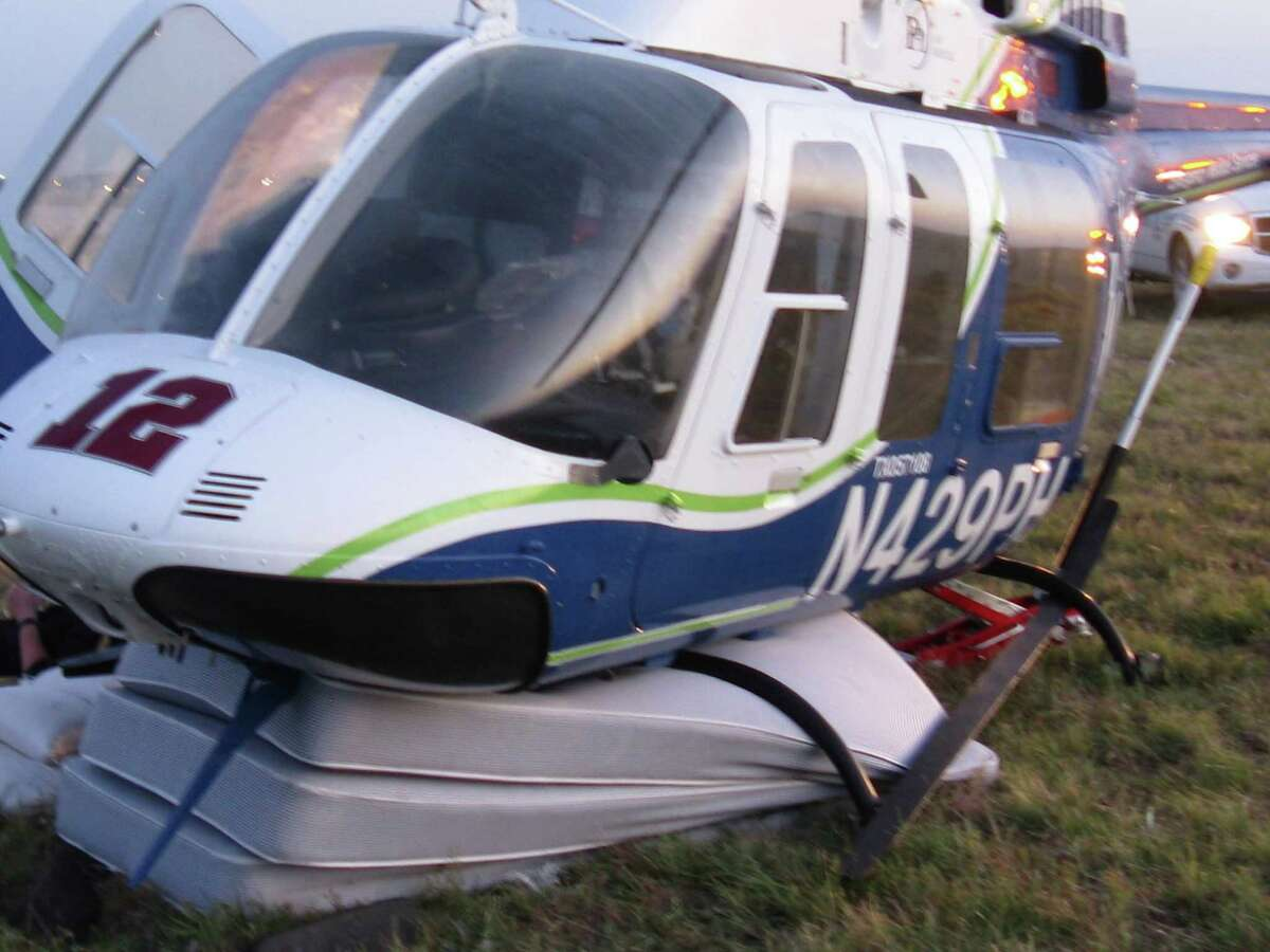 A medical helicopter missing half of its landing gear after hitting a cellphone tower early Sunday made an emergency landing atop three mattresses provided by San Antonio firefighters.
