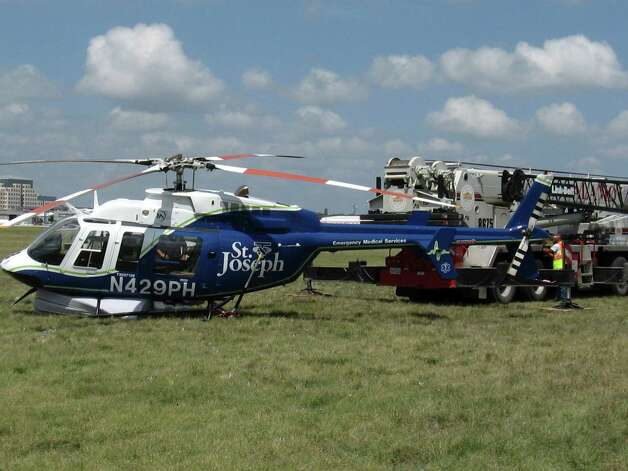 A medical helicopter that landed safely at the San Antonio International Airport after it collided with a cell phone tower and damaged its landing gear. The chopper, which lost one of its two skids, landed successfully on top of three mattresses in San Antonio, Texas on Sunday, August 5, 2012.  Photo courtesy Aircraft Rescue Fire Fighters. Photo: Aircraft Rescue Fire Fighters / Aircraft Rescue Fire Fighters