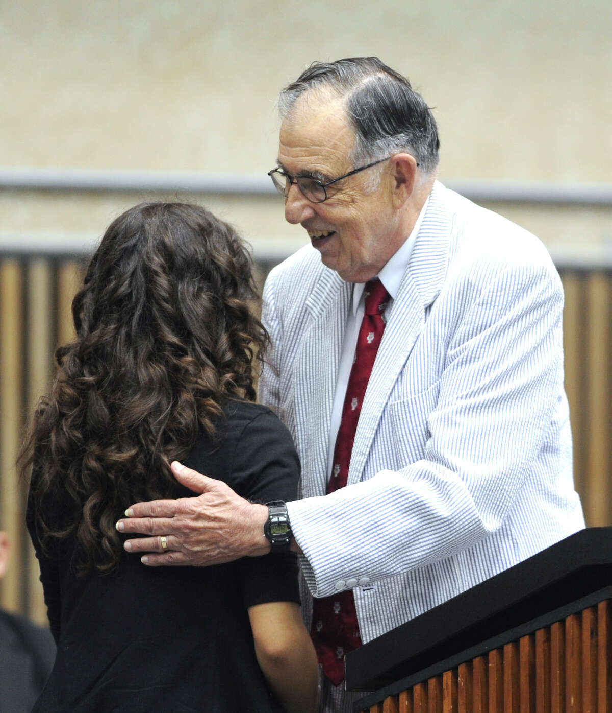 PREP program founder Manuel Berriozabal congratulates student Karla Estrada, of Health Careers High School, who won a scholarship during the PREP Closing Day Assembly at the UTSA Convocation Center on Tuesday, July 31, 2012.