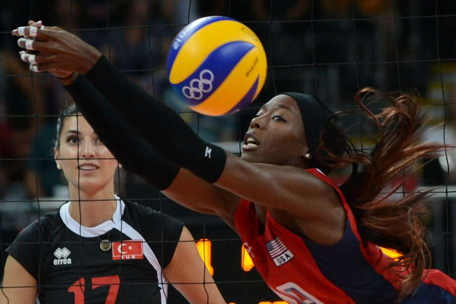 US' Destinee Hooker attempts to set during the Women's preliminary pool B volleyball match between USA and Turkey in the 2012 London Olympic Games in London on August 5, 2012. AFP PHOTO/KIRILL KUDRYAVTSEVKIRILL KUDRYAVTSEV/AFP/GettyImages (AFP/Getty Images)