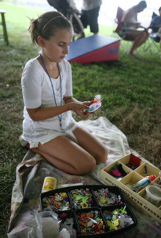 Gabby Rodia, 10 of Trumbull, makes a pin at Festival!, the 7th annual summer festival at the American Shakespeare Theatre in Stratford on Sunday, August 5, 2012. Photo: Brian A. Pounds / Connecticut Post