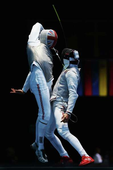 Husayn Rosowsky of Great Britain competes against Tarek Ayad of Egypt during the Men's Foil Team Fen