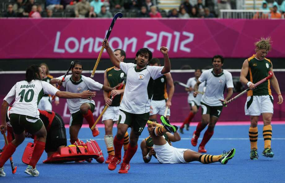 Waseem Ahmad of Pakistan celebrates after scoring the match winning goal against South Africa by 5 goals to 4 during the Men's Hockey match between Pakistan and South Africa at Riverbank Arena Hockey Centre in London. Photo: Daniel Berehulak, Getty Images / 2012 Getty Images