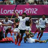 Waseem Ahmad of Pakistan celebrates after scoring the match winning goal against South Africa by 5 goals to 4 during the Men's Hockey match between Pakistan and South Africa at Riverbank Arena Hockey Centre in London.