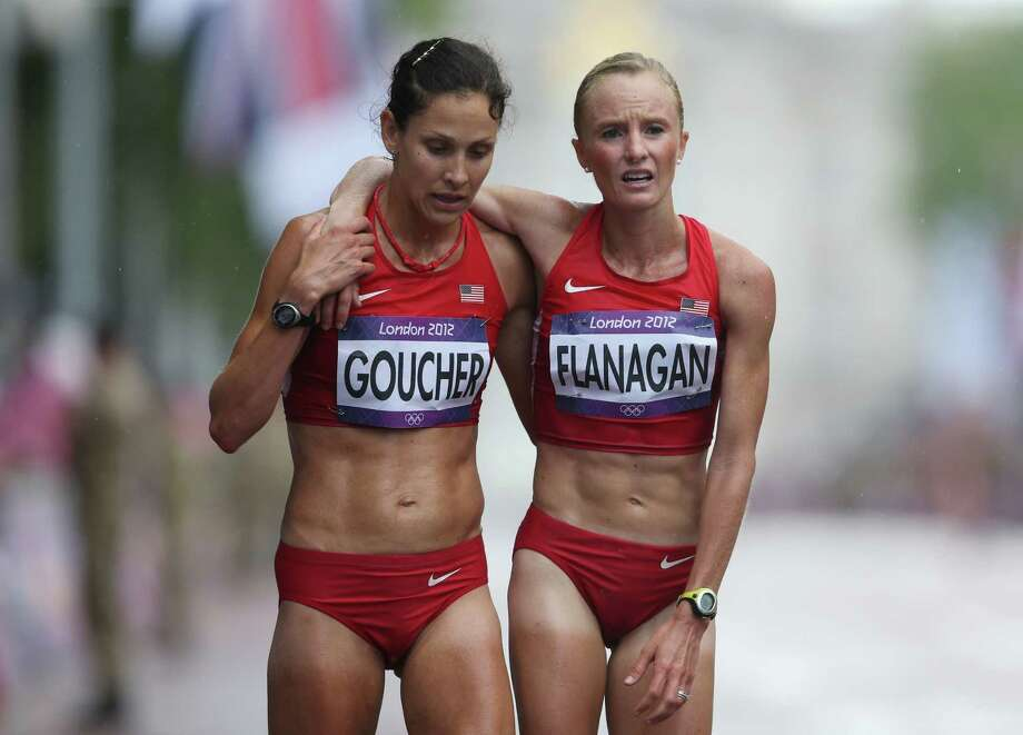 (L-R)  Kara Goucher and Shalane Flanagan of the United States at the finish line after competing during the Women's Marathon. They finished 11th and 10th, respectively. Photo: Streeter Lecka, Getty Images / 2012 Getty Images