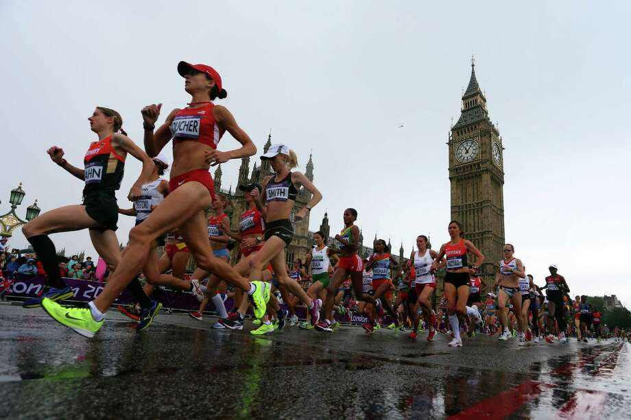 The lead runners in the Women's Marathon pass Parliament on their penultimate circuit. Photo: Alexander Hassenstein, Getty Images / 2012 Getty Images