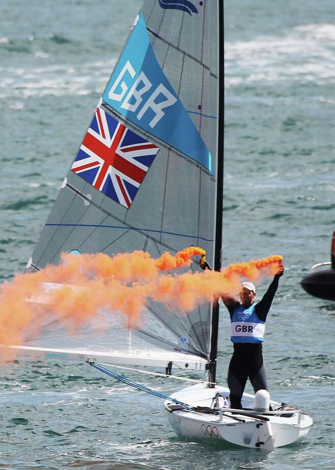 Ben Ainslie of Great Britain celebrates overall victory after competing in the Men's Star Sailing Medal Race at the Weymouth & Portland Venue at Weymouth Harbour in Weymouth, England. Photo: Getty Images / 2012 Getty Images