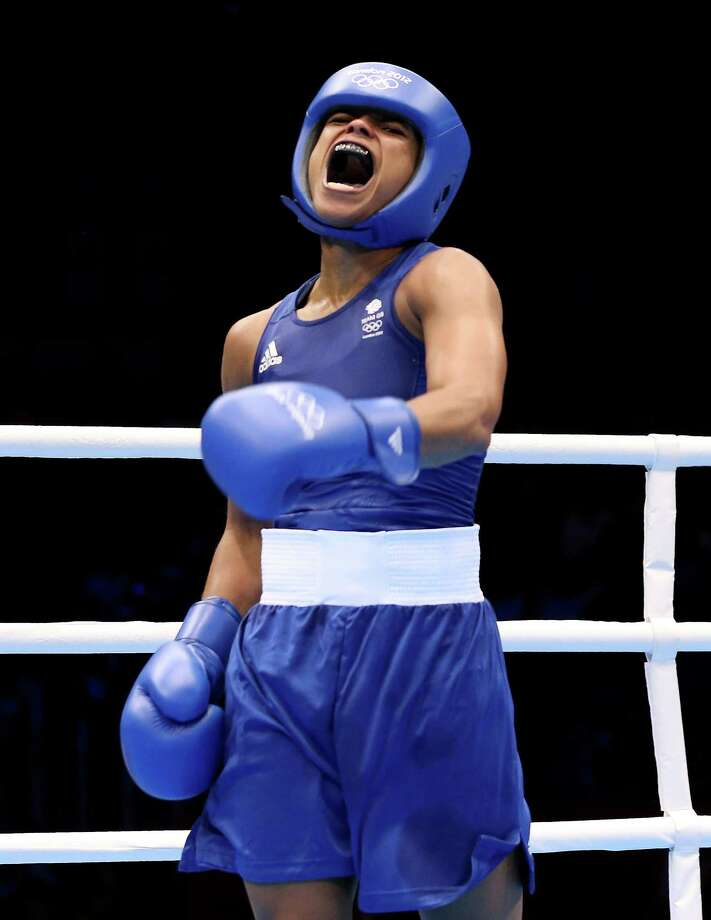 Natasha Jonas of Great Britain celebrates her victory over Quanitta Underwood of United States during the Women's Light (57-60kg) Boxing at ExCeL in London. Photo: Scott Heavey, Getty Images / 2012 Getty Images
