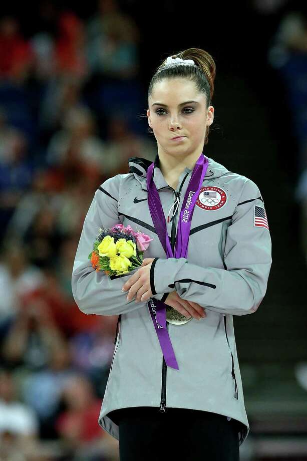 McKayla Maroney of the United States stands on the podium with her silver medal during the medal ceremony following the Artistic Gymnastics Women's Vault final. Photo: Ronald Martinez, Getty Images / 2012 Getty Images