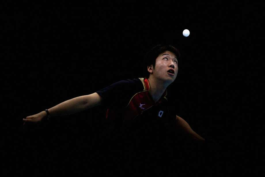 Jun Mizutani of Japan completes during Men's Team Table Tennis quarterfinal match against team of Hong Kong, China. Photo: Feng Li, Getty Images / 2012 Getty Images