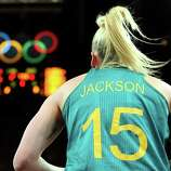 Lauren Jackson #15 of Australia in bounds the ball during the Women's Basketball Preliminary Round match against Canada at the Basketball Arena in London.