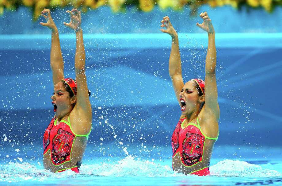 Sona Bernadova and Alzbeta Dufkova of the Czech Republic compete in the Women's Duets Synchronised Swimming Technical Routine at the Aquatics Centre  in London. Photo: Al Bello, Getty Images / 2012 Getty Images