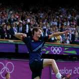 Andy Murray of Great Britain celebrates defeating Roger Federer of Switzerland in the Men's Singles Tennis Gold Medal Match at the All England Lawn Tennis and Croquet Club in London. Murray defeated Federer in the gold medal match in straight sets 6-2, 6-1, 6-4.