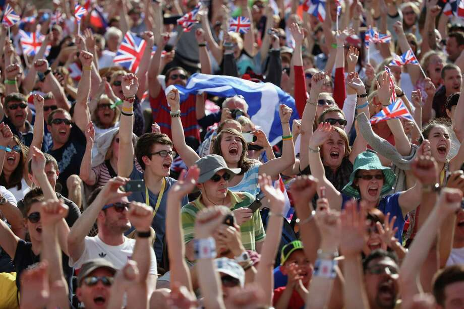 Crowds gather in the Olympic Park on Day 9 to watch Andy Murray on big screens win his gold medal in the Men's Singles Tennis match. Photo: Jeff J Mitchell, Getty Images / 2012 Getty Images