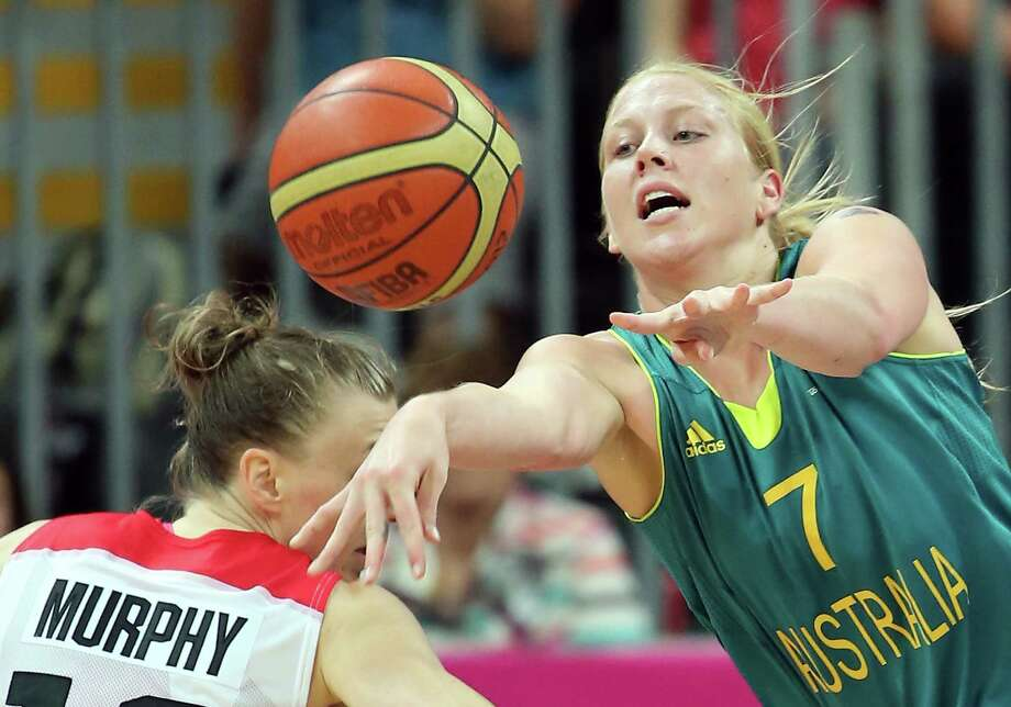 Abby Bishop #7 of Australia passes the ball during the Women's Basketball Preliminary Round match against Canada. Photo: Christian Petersen, Getty Images / 2012 Getty Images