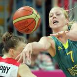 Abby Bishop #7 of Australia passes the ball during the Women's Basketball Preliminary Round match against Canada.